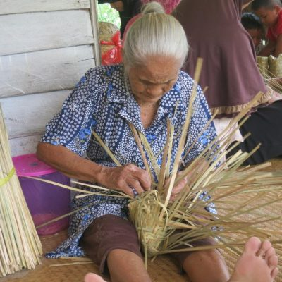 Crafting organic bags for reforestation purposes. Photo by Borneo Nature Foundation